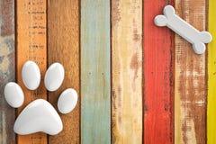 Dog bones on wooden background Stock Photos