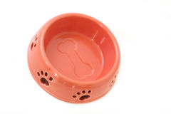 Dog Bowl. Pink ceramic dog bowl with pawprints and bone.  Isolated on white Stock Photo
