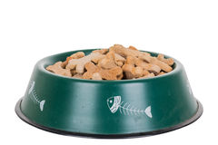 Dog bowl. Filled bowl with cookies in shape of bones Royalty Free Stock Photos