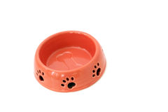 Dog Bowl With Pawprints. Pink ceramic dog bowl with pawprints and bone.  Isolated on white Stock Photo
