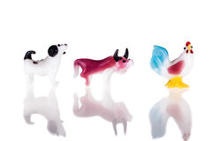 Dog bull and chicken. Small glass sculptures representing the chinese zodiac signs isolated over a pure white background stock images