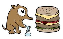 Dog and burger Royalty Free Stock Image