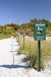 Dog Care Sign on Dunes Stock Images