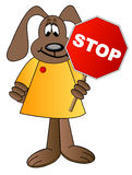 Dog cartoon holding stop sign Stock Images