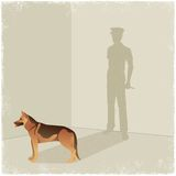Dog casting shadow of guard Stock Photo