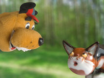 Dog and Cat. (toys), meeting in forest Stock Photo