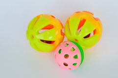 Dog and cat colorful plastic toy ball and bell on white background Stock Photography