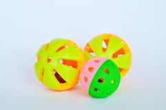 Dog and cat colorful plastic toy ball and bell on white background Royalty Free Stock Image