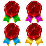 Dog or cat paw wax seal and color ribbon Stock Photos