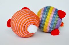 Dog and cat toy ball wrap colorful hemp rope on white background. Dog and cat toy ball wrap colorful hemp rope on the white background stock images