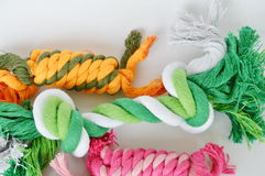 Dog and cat toy colorful fabric rope on white background. Dog and cat toy colorful fabric rope on the white background stock image
