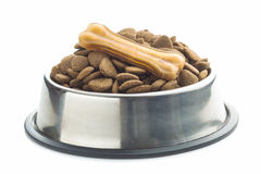 Dog chew bone and dry kibble dog food. Stock Image