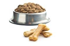 Dog chew bone and dry kibble dog food. Royalty Free Stock Photos