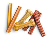 Dog chew bone and sticks. Dog chew bone and sticks isolated on white background Royalty Free Stock Photography