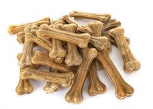 Dog chew bones. In front of white background stock image