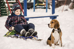Dog and child in the snow Stock Photo