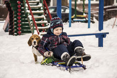Dog and child in the snow Royalty Free Stock Photography