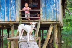 Dog and Children. SANTA RITA, PERU - MARCH 21: Dog guarding the entrance to a house in the village of Santa Rita, Peru on March 21, 2015. Santa Rita is a royalty free stock photography