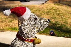 Dog Christmas Decoration wearing a Santa Hat stock image