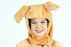 Dog disguise. Cute little girl in dog hat costume ,Halloween concept Stock Photography