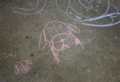 Dog drawn with chalk. On street, children floor and games stock photography