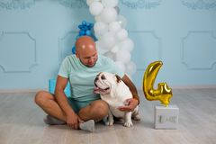 Dog and dude together in studio, portrait.  royalty free stock images