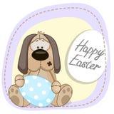 Dog with egg Stock Image