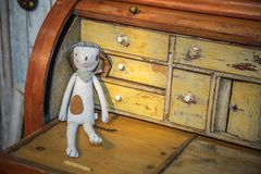 Dog Fabric Sewing Doll on Wooden Vintage and Worn-out Desk stock photography