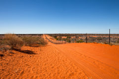 Dog fence Australian outback. Stock Photo