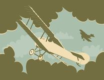 Dog Fight. Vintage looking illustration of a bi plane dog fight Royalty Free Stock Images