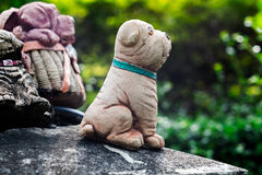 The dog figurines in the garden Stock Photo