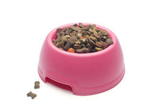Dog food. Studio shot of pink bowl with dog food  on white background Stock Photography
