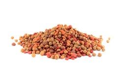 Dog food bits. Pile of dog food bits on a white background Royalty Free Stock Photo