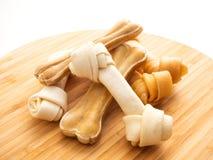 Dog food bone on Chopping Wood on white stock image