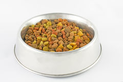 Dog food bowl. Bowl full of dog and cat food over white Stock Images