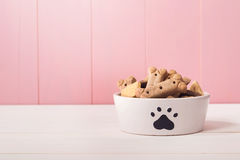 Dog food in a bowl filled with treats Stock Images