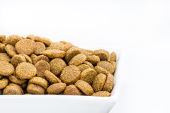 Dog food in a bowl on white background Stock Photography