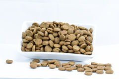 Dog food in a bowl on white Royalty Free Stock Photo