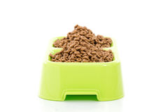 Dog food or cat food in bowl on white background. Stock Photos