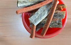 Dog food crispy salmon skin and chicken soft stick on bowl Stock Image