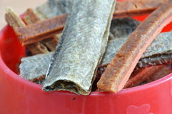 Dog food crispy salmon skin and chicken soft stick on bowl Royalty Free Stock Photography
