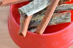 Dog food crispy salmon skin and chicken soft stick on bowl Royalty Free Stock Image