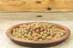 Dog food. A clay plate with pelleted feed Stock Image