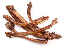 Dog food, dry rib. Isolated on white Stock Photo
