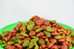 Dog food on green weighting scale Royalty Free Stock Image
