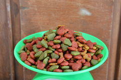 Dog food on green weighting scale Royalty Free Stock Photo