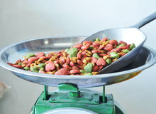 Dog food in iron scoop on weighing scale Royalty Free Stock Images