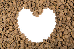 Dog food isolated on white heart background Stock Photos