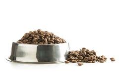 Dog food in metal bowl. Dog food in metal bowl isolated on white background stock image