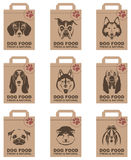 Dog food packages set. Collection of various food packages with dogs heads Stock Images